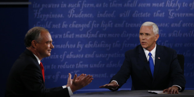 Mike Pence, 2016 Republican vice presidential nominee, right, speaks as Tim Kaine, 2016 Democratic vice presidential nominee, gestures during the vice presidential debate at Longwood University in Farmville, Virginia, U.S., on Tuesday, Oct. 4, 2016. Indiana Governor Mike Pence and Virginia Senator Tim Kaine arrive at tonight's debate with three main assignments: defend their bosses from attack, try to land a few blows, and avoid any mistakes showing them unfit to be president. Photographer: Andrew Harrer/Bloomberg via Getty Images