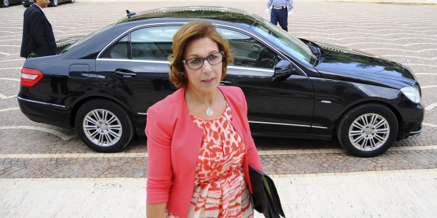 New Tunisian Finance Minister Lamia Zribi arrives for her first cabinet meeting in Tunis, Wednesday Aug. 31, 2016.  Tunisia's Parliament has approved Youssef Chahed as prime minister along with a new government focused on boosting the economy and fighting terrorism.  (AP Photo/Riadh Dridi)