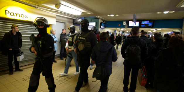 Soldiers and policemen patrol at Brussels' North station, on March 23 2016, one day after the attacks on Brussels airport and at a metro station. About 20 people were killed on the metro and 14 at the airport in the rush-hour assaults, which came just days after the arrest in Brussels of the main fugitive suspect in November's gun and bomb rampage in Paris.  / AFP / BELGA / NICOLAS MAETERLINCK / Belgium OUT        (Photo credit should read NICOLAS MAETERLINCK/AFP/Getty Images)