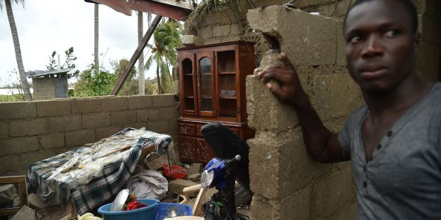 Stanley stands in his destroyed house after the passing of Hurricane Matthew, in Les Cayes, in Southwest Haiti, on October 6, 2016.The storm killed at least 108 people in Haiti, the poorest country in the Americas, with the final toll expected to be much higher. / AFP / HECTOR RETAMAL        (Photo credit should read HECTOR RETAMAL/AFP/Getty Images)