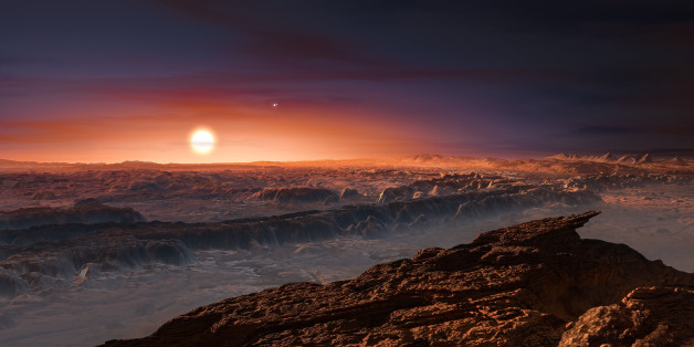 A hand out image made available by the European Southern Observatory on August 24 2016, shows an artist's impression of a view of the surface of the planet Proxima b orbiting the red dwarf star Proxima Centauri, the closest star to the Solar System. The double star Alpha Centauri AB also appears in the image to the upper-right of Proxima itself. Proxima b is a little more massive than the Earth and orbits in the habitable zone around Proxima Centauri, where the temperature is suitable for liquid