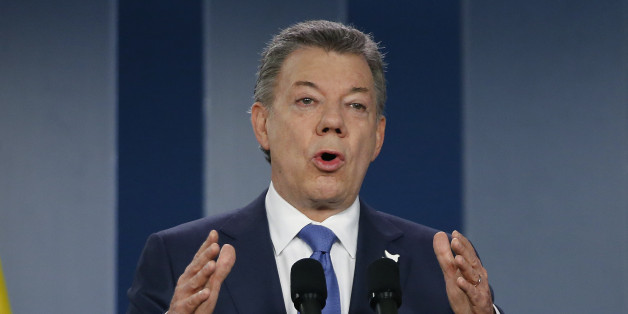 """FILE - In this Wednesday, Oct. 4, 2016 file photo, Colombia's President Juan Manuel Santos delivers a statement to the press after meeting with former President Alvaro Uribe and other opposition leaders at the presidential palace in Bogota, Colombia.  Santos has won the Nobel Peace Prize. The Norwegian Nobel Committee awarded Santos Friday, Oct. 7, """"for his resolute efforts to bring the country's more than 50-year-long civil war to an end."""" (AP Photo/Fernando Vergara, File)"""