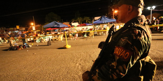 A Philippine soldier keeps watch at a blast site at a night market that has left several people dead and wounded others in southern Davao city, Philippines late Friday Sept. 2, 2016. The powerful explosion in Philippine President Rodrigo Duterte's hometown in the southern Philippines took place amid a security alert due to a major offensive against Abu Sayyaf militants in the region, officials said. (AP Photo/Manman Dejeto)