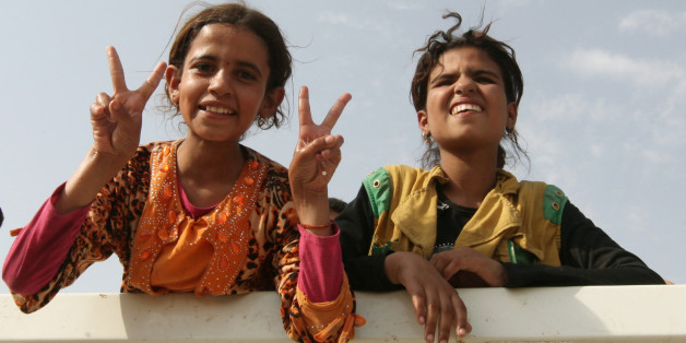 Displaced Iraqi girls from Qayyara sit in a vehicle belonging to Iraqi  security forces 310d089dfd7