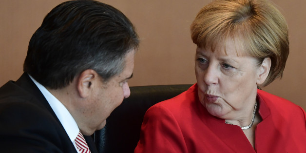 German Chancellor Angela Merkel chats with Vice Chancellor, Economy and Energy Minister Sigmar Gabriel before the weeky cabinet meeting in Berlin on September 28, 2016. / AFP / TOBIAS SCHWARZ        (Photo credit should read TOBIAS SCHWARZ/AFP/Getty Images)