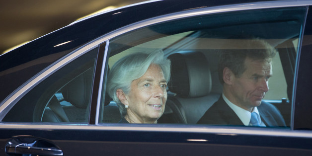 Christine Lagarde, managing director of the International Monetary Fund (IMF), left, and Poul Thomsen, European department director of the International Monetary Fund (IMF), sit in an automobile as they depart emergency talks in Brussels, Belgium, on Thursday, June 25, 2015. Greece and its creditors are holding marathon emergency talks, struggling to break a five-month impasse that has brought the country to the cusp of default as the end of its bailout program next Tuesday lurches ever closer. Photographer: Jasper Juinen/Bloomberg via Getty Images