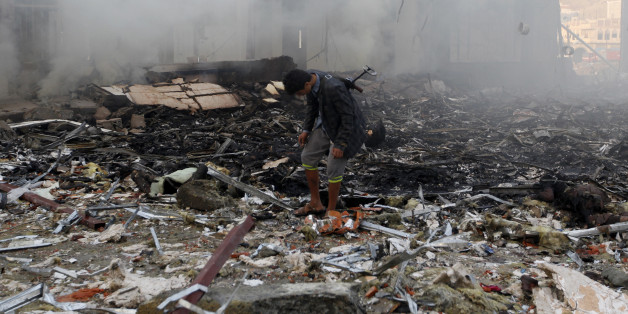 A Yemeni inspects the rubble of a destroyed building following reported airstrikes by Saudi-led coalition air-planes on the capital Sanaa on October 8, 2016.Rebels in control of Yemen's capital accused the Saudi-led coalition fighting them of killing or wounding dozens of people in air strikes on Sanaa. The insurgent-controlled news site sabanews.net said that coalition planes hit a building in the capital where people had gathered to mourn the death of an official, resulting in 'dozens of dead