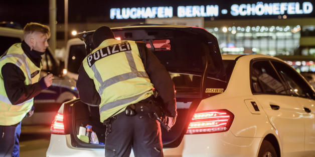 SCHOENEFELD, GERMANY - OCTOBER 08: Police check arriving cars outside Schoenefeld Aiport near Berlin following the launch of a manhunt for a terror suspect on October 8, 2016 in Schoenefeld, Germany. Police raided an apartment earlier in the day in Chemnitz, where they discovered high explosives and made several arrests. One suspect, a Syrian man, remains at large. (Photo by Clemens Bilan/Getty Images)