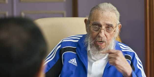 Cuba's former leader Fidel Castro talks with China's Premier Li Keqiang in Havana, Cuba, Sunday, Sept. 25, 2016. Li Keqiang is on a two-day official visit to Cuba. (AP Photo/Alex Castro)