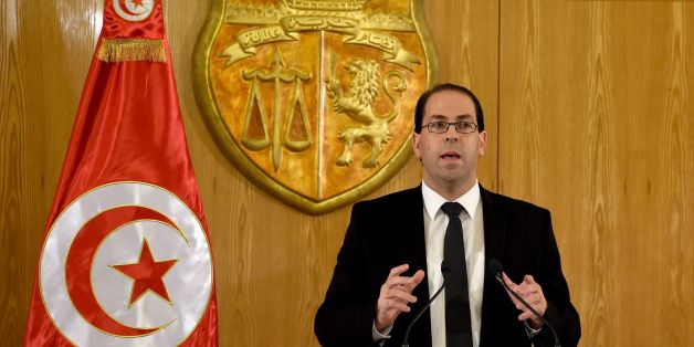 Tunisia's premier-designate Youssef Chahed speaks during a press conference to present his proposed new unity government list after he submitted it to the president on August 20, 2016 in Carthage, near the capital Tunis. Chahed, a 40-year-old former local affairs minister and member of the Nidaa Tounes party, had been given 30 days to form a cabinet. If his cabinet wins the backing of parliament, Chahed will become the North African country's youngest premier since independence from France in 19