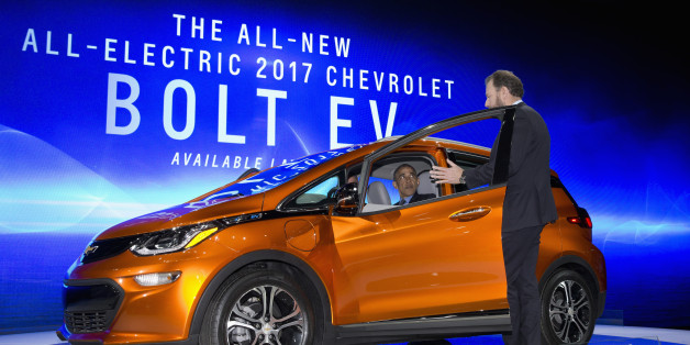 President Barack Obama sits in a new Chevrolet Bolt electric car as he visits the 2016 North American International Auto Show in Detroit, Wednesday, Jan. 20, 2016, to highlight the progress made by the American auto industry. (AP Photo/Carolyn Kaster)