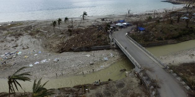 Aerial picture showing the destruction caused by Hurricane Matthew in Port-Salut, southwest of Port-au-Prince, on October 9, 2016, days after the passage of the hurricane through Haiti. Haiti began three days of mourning on Sunday for hundreds killed in Hurricane Matthew as relief officials grappled with the unfolding devastation in the Caribbean country's hard-hit south. And nearly a week after being devastated by the hurricane, Haiti is confronted with a growing cholera outbreak threatening to turn its disaster even more deadly. / AFP / Nicolas GARCIA        (Photo credit should read NICOLAS GARCIA/AFP/Getty Images)