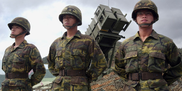 """** FILE *Taiwanese soldiers stand at attention in front of one of Taiwan's many Patriot missile air defense systems near the northern coastal town of Wanli, Taiwan in this Friday, Oct. 22, 2004 file photo. A defense ministry official says Taiwan is working on setting up a """"think tank"""" to coordinate contacts with the Chinese military, in what would be one of the most significant steps so far in rapidly improving relations between the sides. (AP Photo/Wally Santana, File)"""