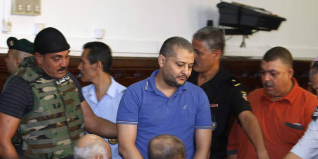 Imed Trabelsi (C), a nephew of ousted Tunisian President Zine al-Abidine Ben Ali, arrives for a third trial hearing at a court in Tunis August 10, 2011. The trial of 23 relatives and allies of Ben Ali, charged with trying to illegally flee the country, resumed on Wednesday. REUTERS/Zoubeir Souissi  (TUNISIA - Tags: POLITICS CRIME LAW)