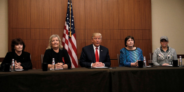 Republican presidential nominee Donald Trump sits with (from R-L) Paula Jones, Kathy Shelton, Juanita Broaddrick, Kathleen Willey in a hotel conference room in St. Louis, Missouri, U.S., shortly before the second presidential debate at Washington University in St. Louis, October 9, 2016.  REUTERS/Mike Segar     TPX IMAGES OF THE DAY
