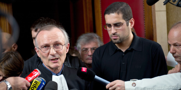 Hilam Hicheur (2ndR), brother of Adlene Hicheur who worked for Cern (European Centre for Nuclear Research) in Switzerland, and his lawyer Patrick Baudouin (L) speak to journalists following the judgment of the trial on May 4, 2012 at the Paris Courthouse. Adlene Hicheur, already on a 2-year pre-trial detention, was sentenced to four years of imprisonment  for being connected to an Al-Qaeda's North African wing (AQMI) alleged to have planned attacks in France.  AFP PHOTO BERTRAND LANGLOIS