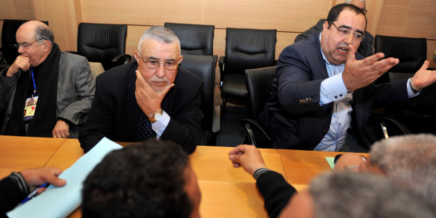Abdelouahed Radi (2-R), secretary general of Morocco's Socialist Party (USFP) listens to questions as party members Driss Lachgar (R) speaks and Fathallah Oualalou (L) looks on at the National council in Rabat on March 19, 2011.  Radi spoke during a session regarding recent protests across the country.  AFP PHOTO / ABDELHAK SENNA (Photo credit should read ABDELHAK SENNA/AFP/Getty Images)