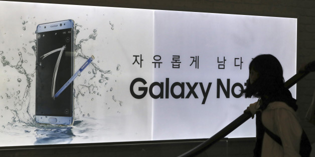 A visitor passes by an advertisement of the Samsung Electronics Galaxy Note 7 smartphone at its shop in Seoul, South Korea, Tuesday, Oct. 11, 2016. Samsung said Tuesday it is halting sales of the star-crossed Galaxy Note 7 smartphone after a spate of fires involving new devices that were supposed to be safe replacements for recalled models. (AP Photo/Lee Jin-man)