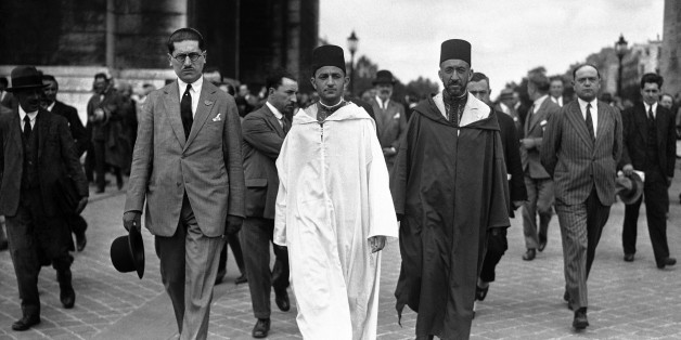 The Sultan of Morocco, Mohammed V wearing white robes, walking with the Grand Vizier, Si Mohammed El Mokri after he placed his wreath on the Tomb of the Unknown Warrior at the Arc De Triomphe during a visit to Paris, France around July 4, 1930. (AP Photo)