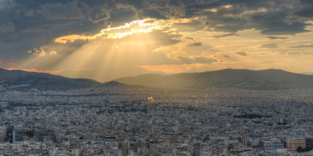 Rays of sunlight breaking through dramatic clouds over Athens, Greece