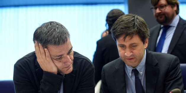 Greek Finance Minister Euclid Tsakalotos (L) listens to a Greek advisor during an Eurogroup meeting in Luxembourg on October 10, 2016.Greece has delivered the reforms necessary to unlock 2.8 billion euros in rescue loans from its massive third bailout, the European Commission's top economics affairs official said on October 10, 2016. / AFP / JOHN THYS        (Photo credit should read JOHN THYS/AFP/Getty Images)