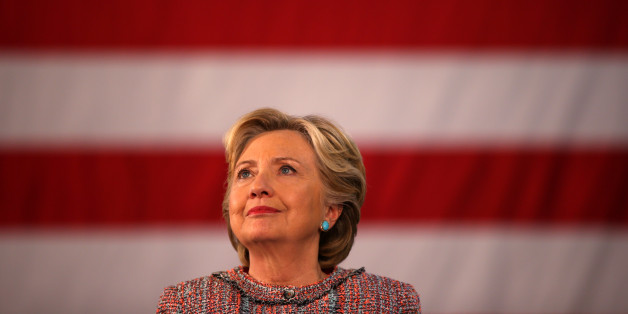 U.S. Democratic presidential nominee Hillary Clinton listens to former Vice President Al Gore talk about climate change at a rally at Miami Dade College in Miami, Florida, U.S. October 11, 2016. REUTERS/Lucy Nicholson