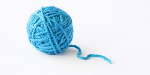 Blue ball of wool, studio shot