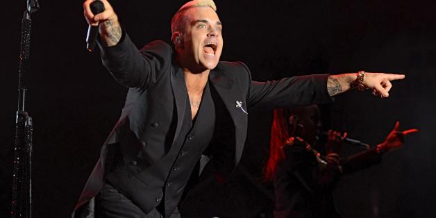 Sänger Robbie Williams bewegt sich viel auf der Bühne - doch jetzt macht ihm sein Rücken zu schaffen
