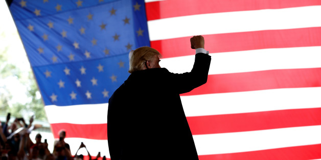 Republican U.S. presidential nominee Donald Trump reacts to cheers as he takes the stage at a campaign rally in Ocala, Florida, U.S., October 12, 2016.   REUTERS/Mike Segar