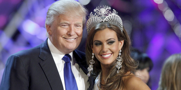 Donald Trump, co-owner of the Miss Universe Organization, poses with Miss Connecticut Erin Brady at a news conference after she was crowned Miss USA 2013 at the Planet Hollywood Resort and Casino in Las Vegas, Nevada June 16, 2013. REUTERS/Steve Marcus (UNITED STATES - Tags: ENTERTAINMENT BUSINESS) FOR EDITORIAL USE ONLY. NOT FOR SALE FOR MARKETING OR ADVERTISING CAMPAIGNS