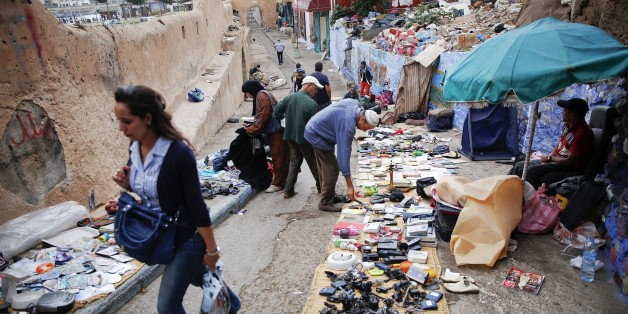 "People look for items at a small flea market behind Bab el Bahr gates of Rabat's Medina September 21, 2014.   UNESCO made Rabat a World Heritage Site two years ago and media and tour operators call it a ""must-see destination."" But it seems the tourist hordes have yet to find out. While visitors are getting squeezed through the better-known sites of Marrakesh and Fez, the old part of Rabat - with its beautiful Medina and Kasbah of the Udayas - remains an almost unspoiled oasis of calm. Smaller an"