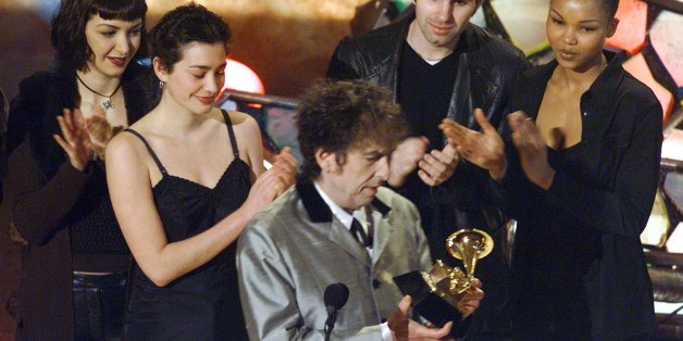 Bob Dylan accepts his Grammy Awards after winning for album of the year at the Grammy Awards February 25. [Dylan shared the award with producer Daniel Lanois].     ??»