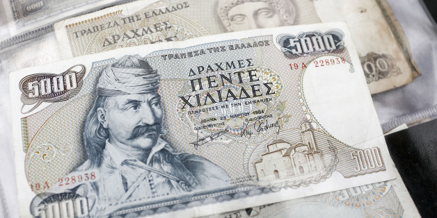 The image of Theodoros Kolokotronis, a Greek general and leader of the Greek War of Independence against the Ottoman empire, sits on an old Greek five thousand drachma banknote at it sits on display at a street vendors's stall at the Monastiraki flea market in Athens, Greece, on Saturday, July 11, 2015. European officials are grilling Greece on its bailout proposals in talks to save its place in the euro as a German-led bloc questions whether they go far enough. Photographer: Kostas Tsironis/Bloomberg via Getty Images