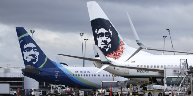 FILE - In this Monday, April 4, 2016, file photo, Alaska Airlines planes with the company's new livery and tail logo, left, and the old livery used to promote service to Hawaii, right, are shown parked at Seattle-Tacoma International Airport in Seattle. Alaska Airlines and JetBlue Airways still rank highest in the annual J.D. Power survey of passengers on the nine largest North American airlines, and the firm says overall traveler satisfaction with the industry is at a 10-year high. J.D. Power s