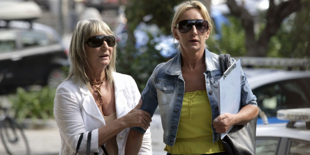 KOS, GREECE - OCTOBER 22:  Kerry Grist (C) and her mother Christine Needham prepare to make a statement to the media as British police continue the search for Mrs Grist's son Ben Needham, who went missing 21 years ago, on October 22, 2012 in Kos, Greece. The toddler from Sheffield was 21 months old when he vanished on the Greek island in July, 1991. Specialist British search teams and Greek police started excavating the site last week. (Photo by Milos Bicanski/Getty Images)