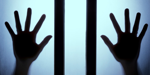 Silhouette of the hand on glass