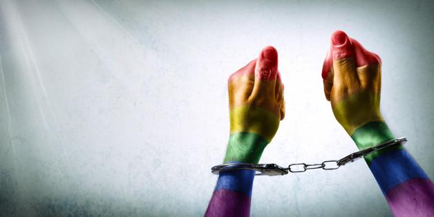 handcuffed hands -  discrimination concept