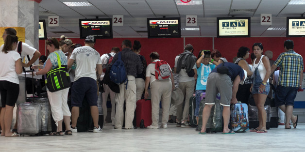 Tourists line up at Monastir airport as they prepare to leave Tunisia, a day after a shooting attack which took place in the coastal town of Sousse Saturday, June 27, 2015. Tunisia's prime minister announced on Saturday a string of new security measures including closing renegade mosques and calling up army reservists as thousands of tourists fled the North African country in wake of its worst terrorist attack ever. Tourists crowded into the airport at Hammamet near the coastal city of Sousse wh