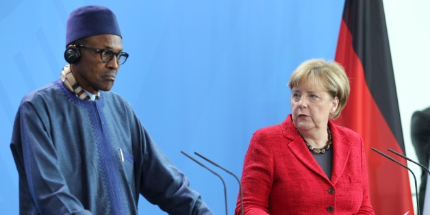 BERLIN, GERMANY - OCTOBER 14: German Chancellor Angela Merkel and Nigerian President Muhammadu Buhari (L) hold a joint press conference after their meeting in Berlin, Germany on October 14, 2016.  (Photo by Erbil Basay/Anadolu Agency/Getty Images)