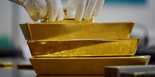 An employee places gold bars in the Kazakhstan s National Bank vault in  Almaty df986b93c01