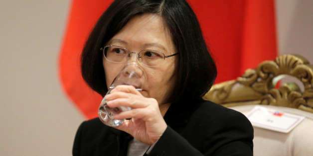 Taiwan's President Tsai Ing-wen drink water during an interview in Luque, Paraguay, June 28, 2016. REUTERS/Jorge Adorno