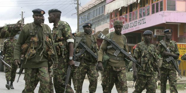 Kenyan Army soldiers patrol the centre of the town of Naivasha January 27, 2008. At least 10 people were killed in ethnic fighting in Naivasha on Sunday as rival tribal gangs set fire to homes and blocked roads. REUTERS/Peter Andrews (KENYA)