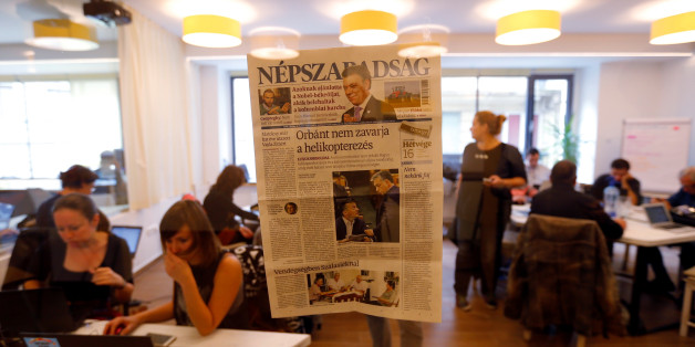 A copy of the last issue of the leftist newspaper Nepszabadsag, which was unexpectedly shut down on Saturday amid cries of a crackdown by right-wing Prime Minister Viktor Orban's government, hangs on the wall of a temporary newsroom in Budapest, Hungary, 10 October, 2016. REUTERS/Laszlo Balogh