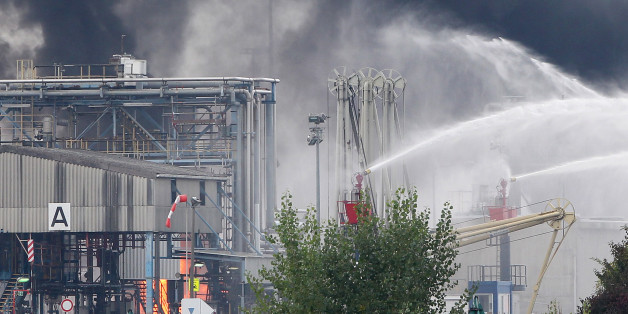 Firemen try to extinguish the fire in the Chemical plant of the BASF site in Ludwigshafen, western Germany on October 17, 2016.Several people were missing and others were injured after an explosion at a chemical plant at BASF's headquarters in western Germany, the firm said, advising local people to stay indoors. / AFP / DANIEL ROLAND        (Photo credit should read DANIEL ROLAND/AFP/Getty Images)