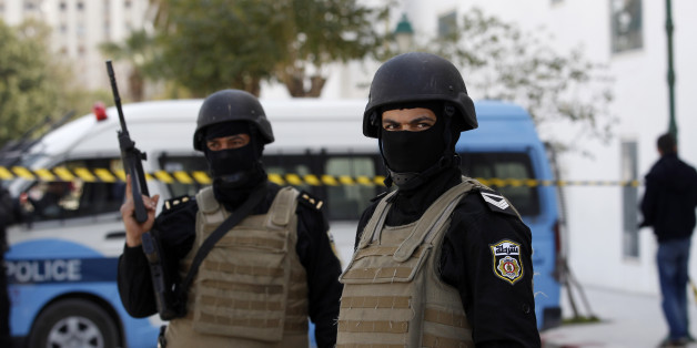 Police officers guard the entrance of the National Bardo Museum a day after gunmen opened fire killing scores of people in Tunis, Thursday, March 19, 2015. One of the gunmen who killed tourists and others at a prominent Tunisian museum was known to intelligence services, but no formal links to a particular extremist group have been established, the prime minister said Thursday. (AP Photo/Christophe Ena)