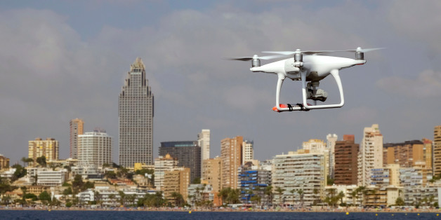 A drone, equipped with a camera used by police for surveillance tasks, flies in front of Poniente beach at the eastern costal town of Benidorm, Spain, August 18, 2016. REUTERS/Heino Kalis