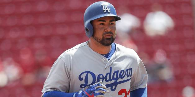 Los Angeles Dodgers' Adrian Gonzalez runs the bases after hitting a solo home run off Cincinnati Reds relief pitcher Jumbo Diaz in the seventh inning of a baseball game, Monday, Aug. 22, 2016, in Cincinnati. (AP Photo/John Minchillo)