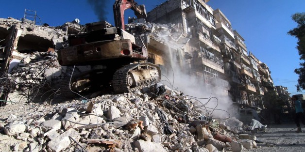ALEPPO, SYRIA - OCTOBER 17: Heavy construction equipment clears the collapsed buildings after War Crafts belonging to the Russian army carried out over opposition controlled residential areas at Katirci town of Aleppo, Syria on October 17, 2016. (Photo by Jawad al Rifai/Anadolu Agency/Getty Images)