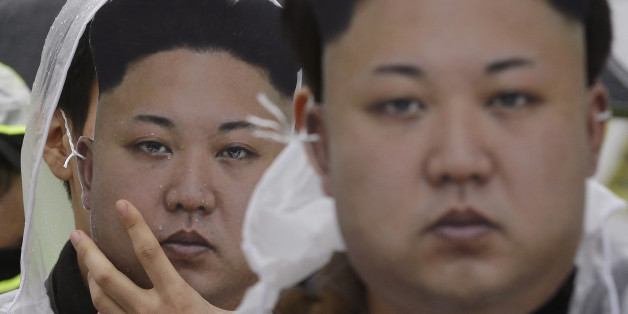 North Korean defectors wearing masks of North Korean leader Kim Jong Un attend a rally against North Korea's rocket launch and nuclear test in Seoul, South Korea, Friday, Feb. 12, 2016. South Korea has cut off power and water supplies to a factory park in North Korea, officials said Friday, a day after the North deported all South Korean workers there and ordered a military takeover of the complex that had been the last major symbol of cooperation between the rivals. (AP Photo/Ahn Young-joon)