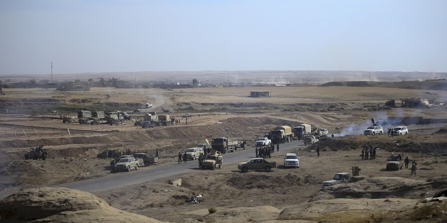 NINEVEH, IRAQ - OCTOBER 18: Peshmerga forces belonging to the Iraqi Kurdish Regional Government (IKRG) located at Hazir front in the Hasan Sam village are on their way to Besika with their armoured vehicles during an operation to retake Iraq's Mosul from Deash in Nineveh, Iraq on October 18, 2016. A much anticipated Mosul offensive to liberate the city from Deash began midnight Sunday, according to Iraqi Prime Minister. (Photo by Emrah Yorulmaz/Anadolu Agency/Getty Images)